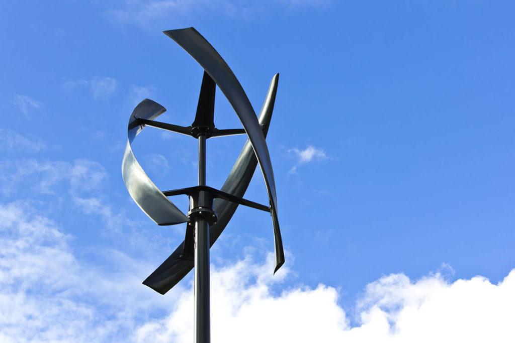 11143486 - silent urban styled wind turbine, blue sky.